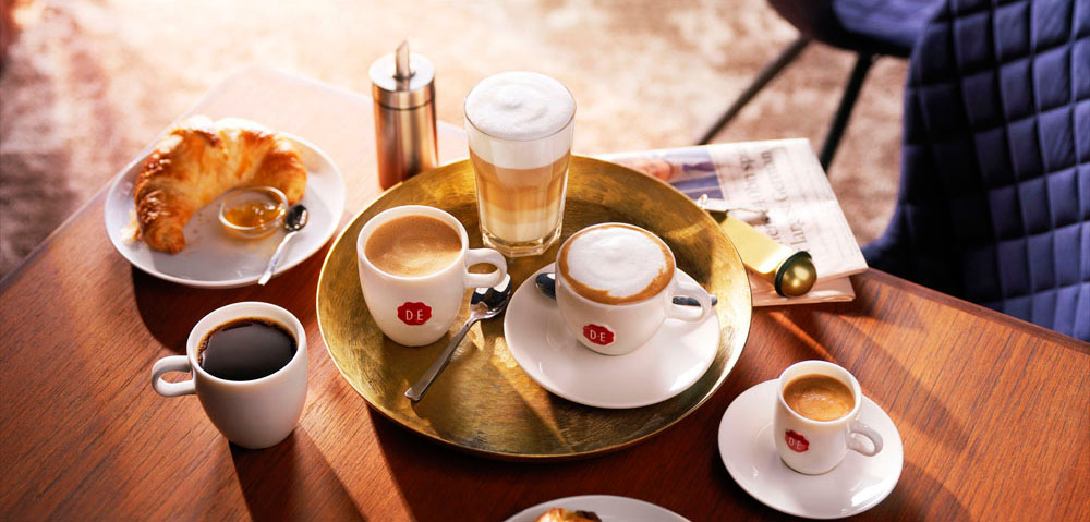 Drinks photography of cups and a glass of coffee with a croissant made by Studio_m Photography Amsterdam