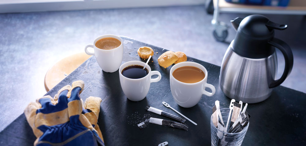 Drinks styling photography of JDE's three cups of coffee with cookies and a coffeepot made by Studio_m Photography Amsterdam