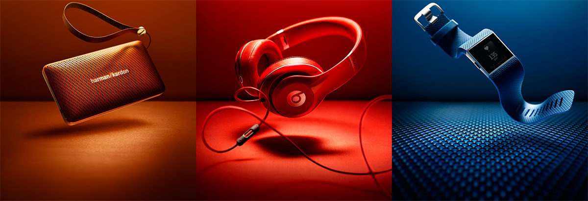 Product photography of Harman's purse, red headphone and a blue portable device made by Studio_m Photography Amsterdam