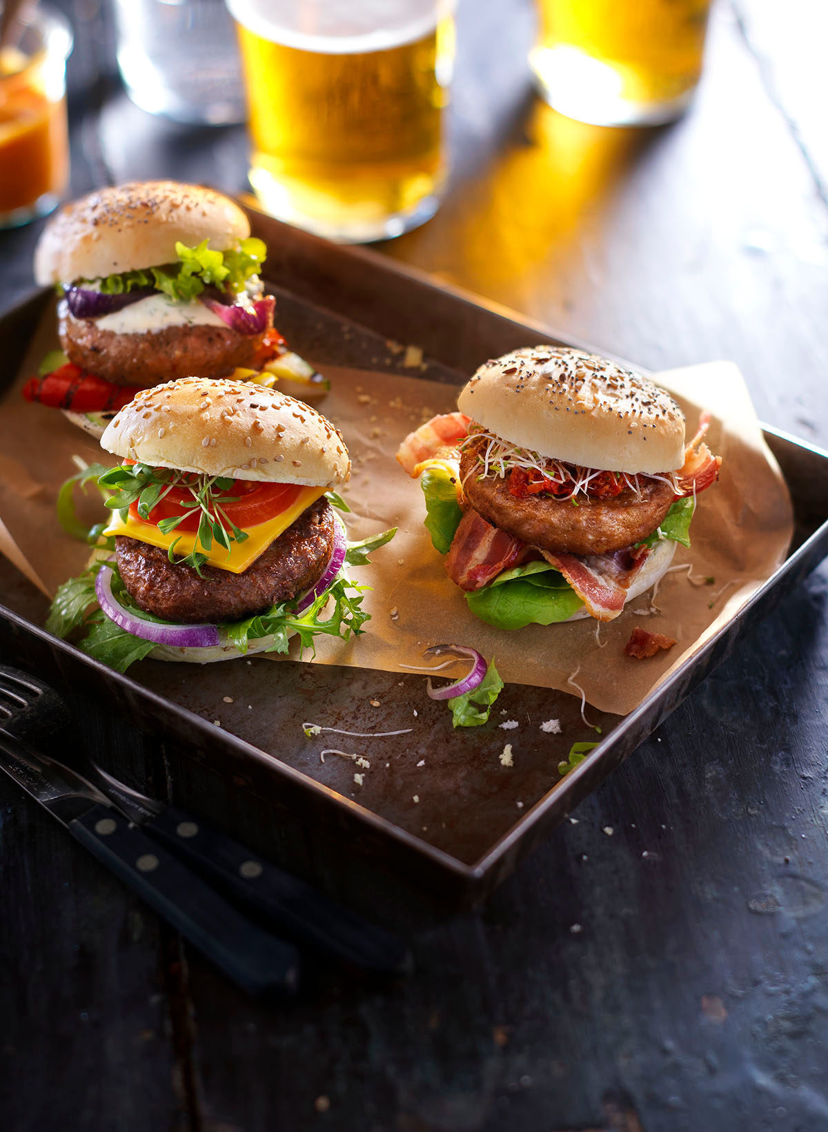 Food styling photography of three of TopKing's hamburgers with beer made by Studio_m Photography Amsterdam