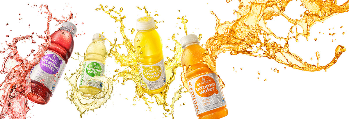 Drinks packshots photography of four Sourcy vitamin water bottles splashing made by Studio_m Photography Amsterdam