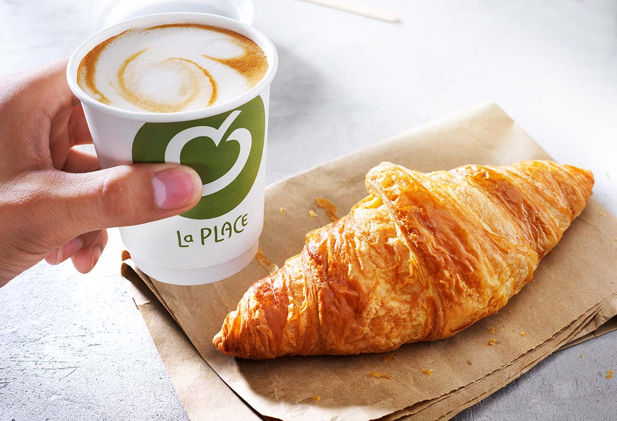 Food photography of a croissant with a cup of coffee from La Place made by Studio_m Photography Amsterdam