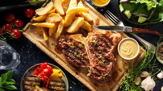 Food photography of T-bone steak with potato made by Studio_m Photography Amsterdam